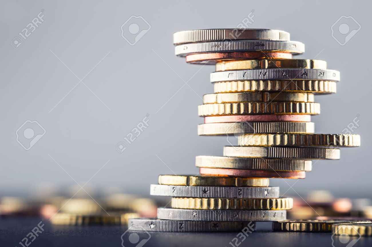 Euro coins. Euro money. Euro currency.Coins stacked on each other in different positions. Money concept. - 52807937