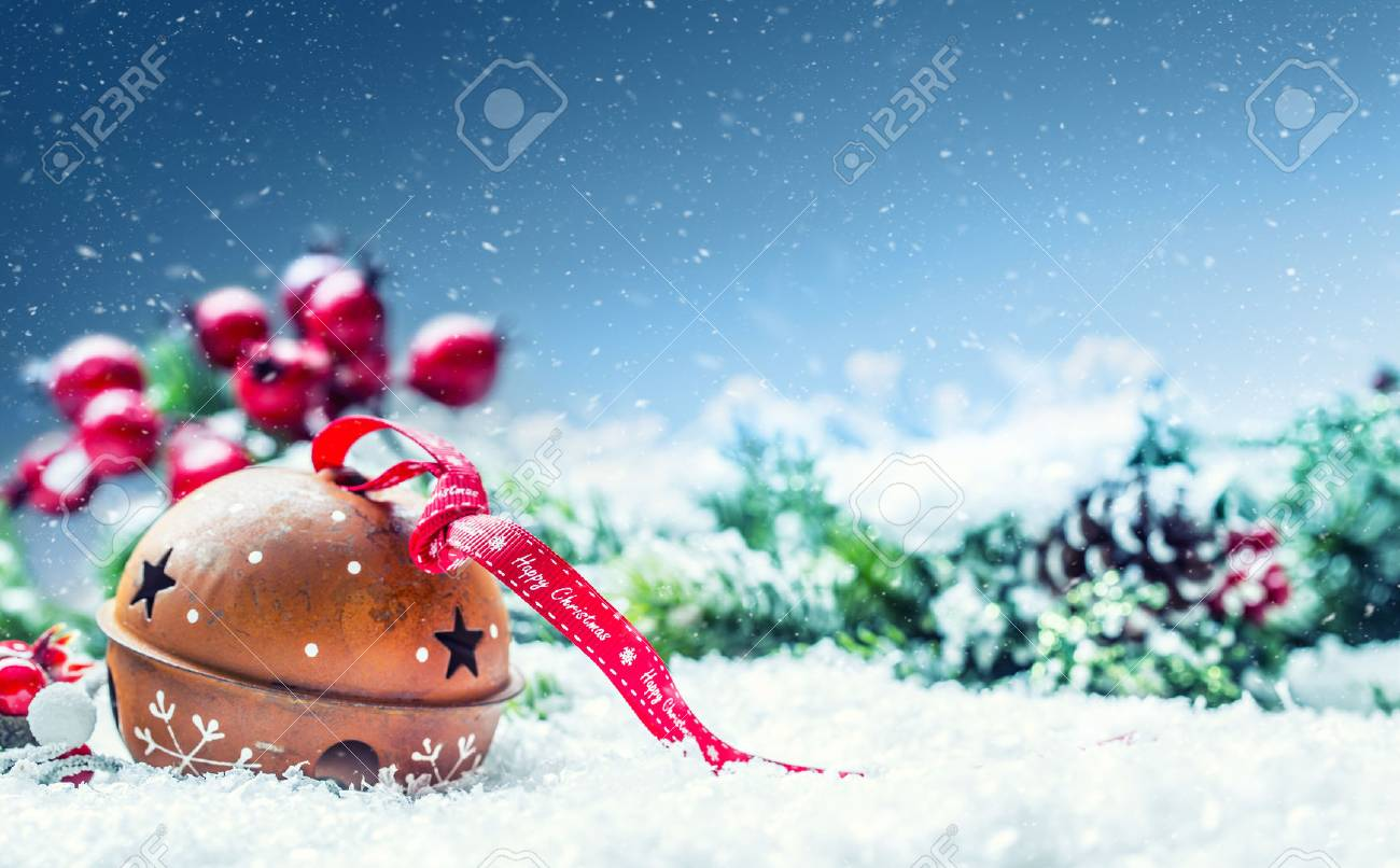 Christmas balls jingle bells. Red ribbon with text Happy Christmas. Snowy abstract background and decoration. - 63264369