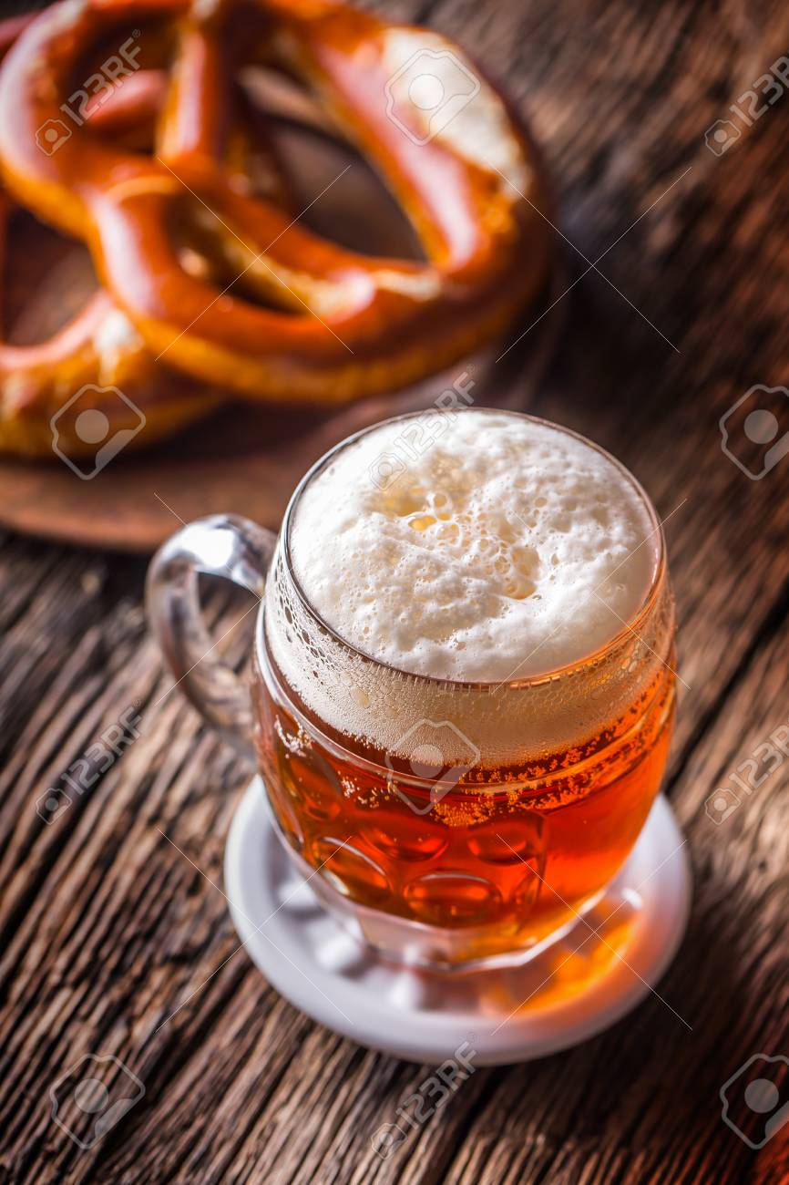 beer and oktoberfest draft beer pretzel and blue checkered