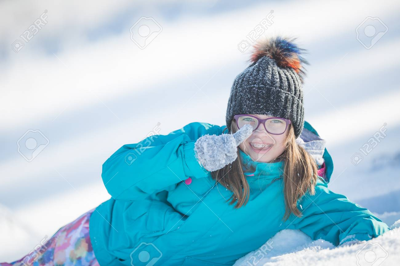 dfa4c79577a2 Happy Young Pre-Teen Girl In Warm Clothing Playing With Snow. Stock ...