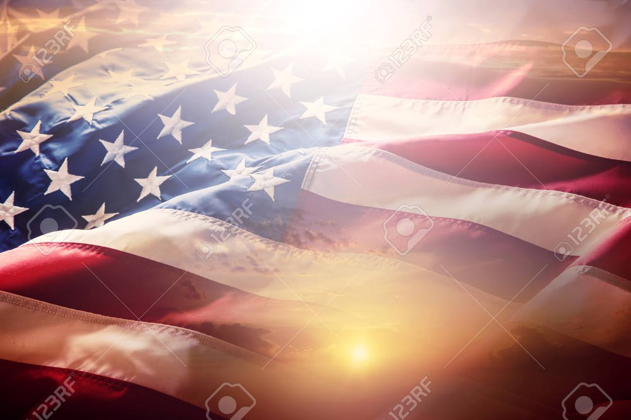 USA flag. American flag. American flag blowing wind at sunset or sunrise. Close-up. - 93627449