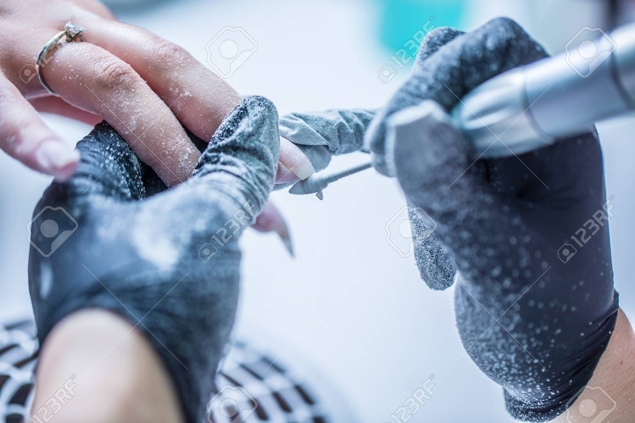 Repairing Old Gel Nails With A Nail Grinder In Nail Studio -.. Stock ...