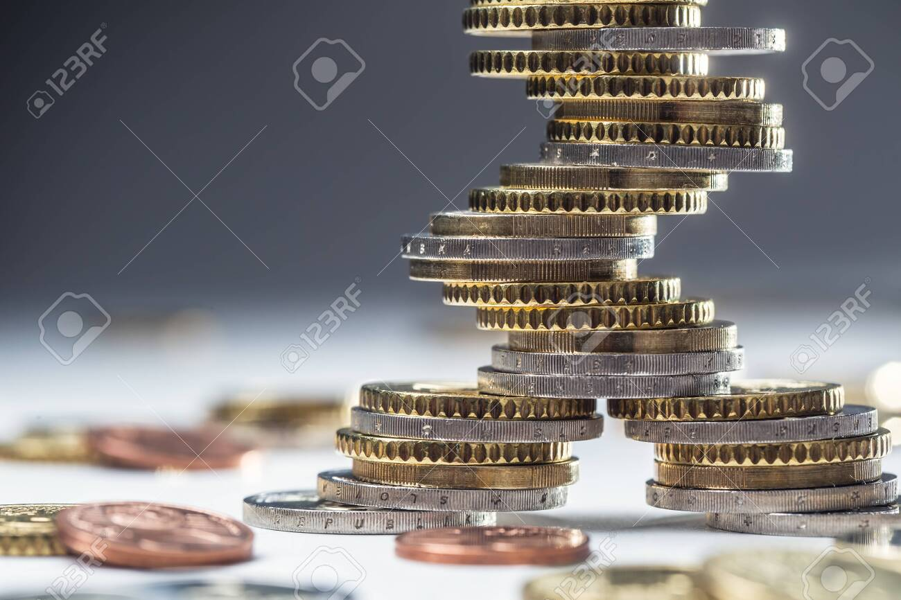 Euro coins stacked on each other in different positions. Close-up european money and currency. - 120094496