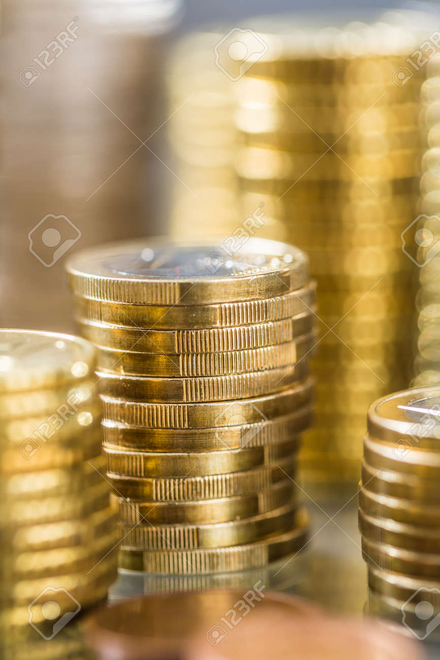 Towers of the euro coins stacked in different positions. - 121279874