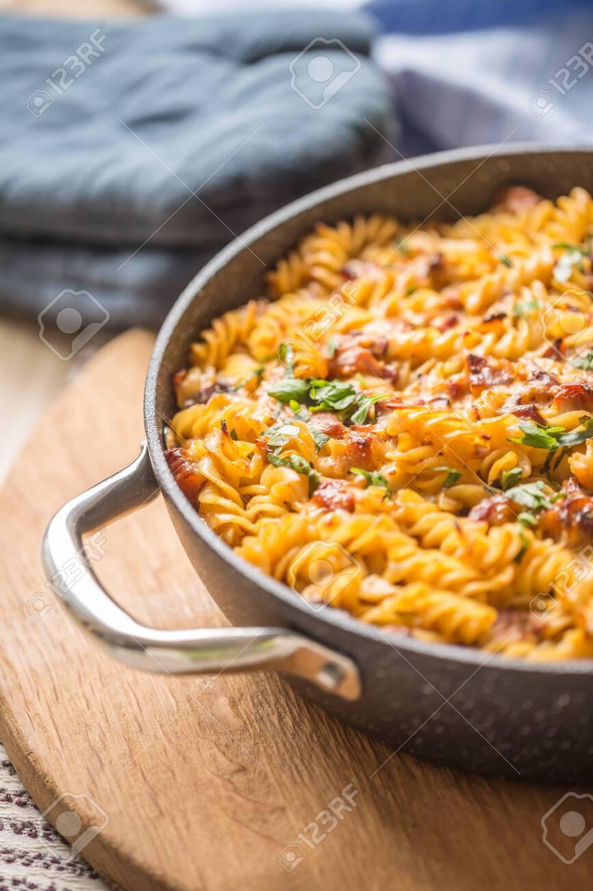 Baked pasta fusilli with smoked pork neck mozzarela cheese and othe ingredients. - 135143316