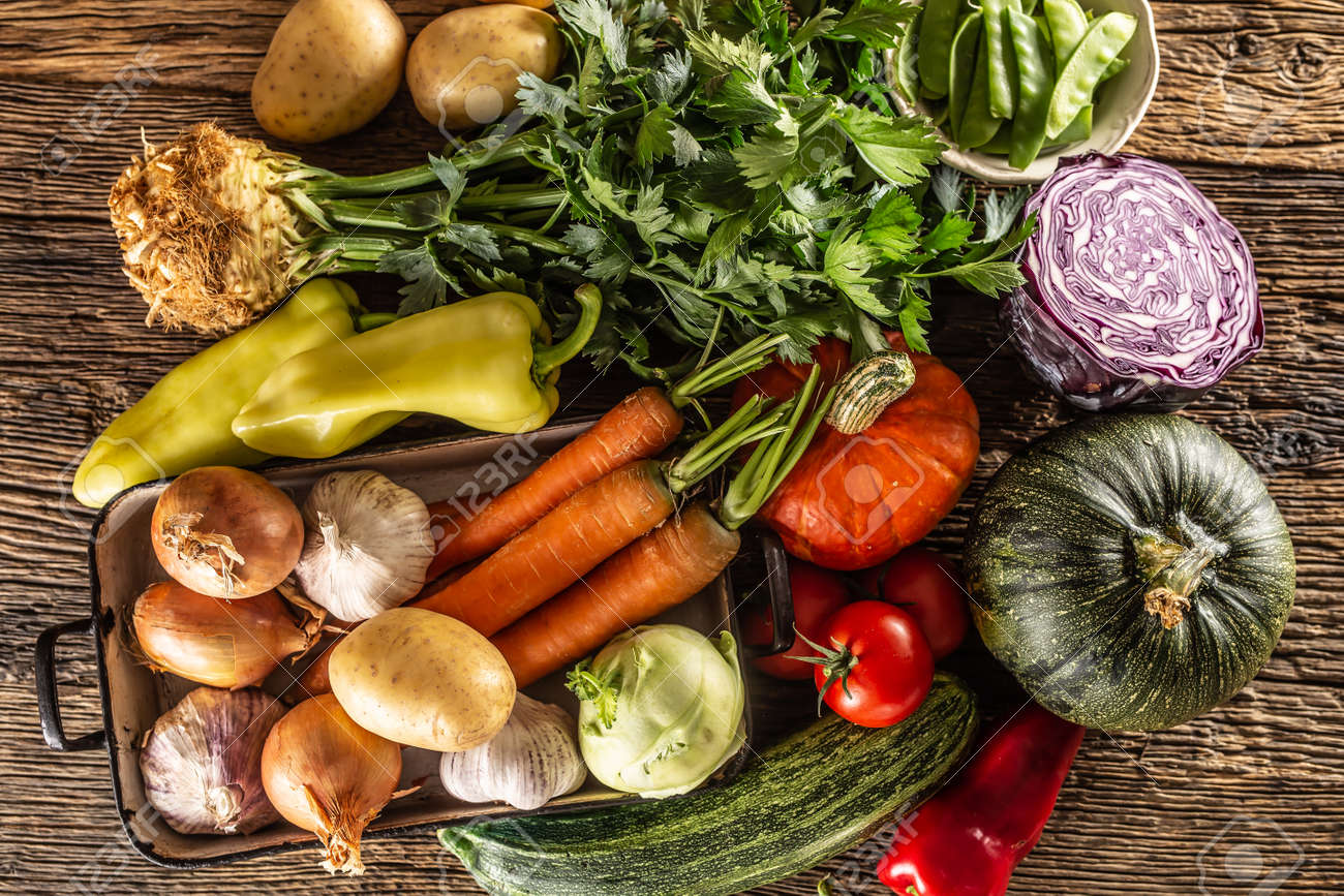 Selection of autumn vegetable harvest from the top on a rustic surface. - 155721793