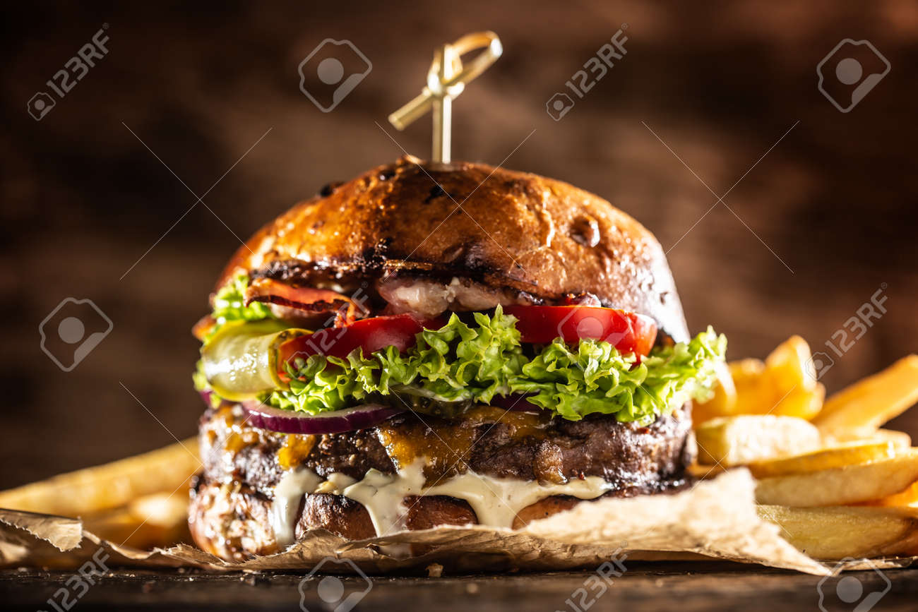 Classic beef burger with cheese cheddar bacon wegetable and french fries. - 159431913