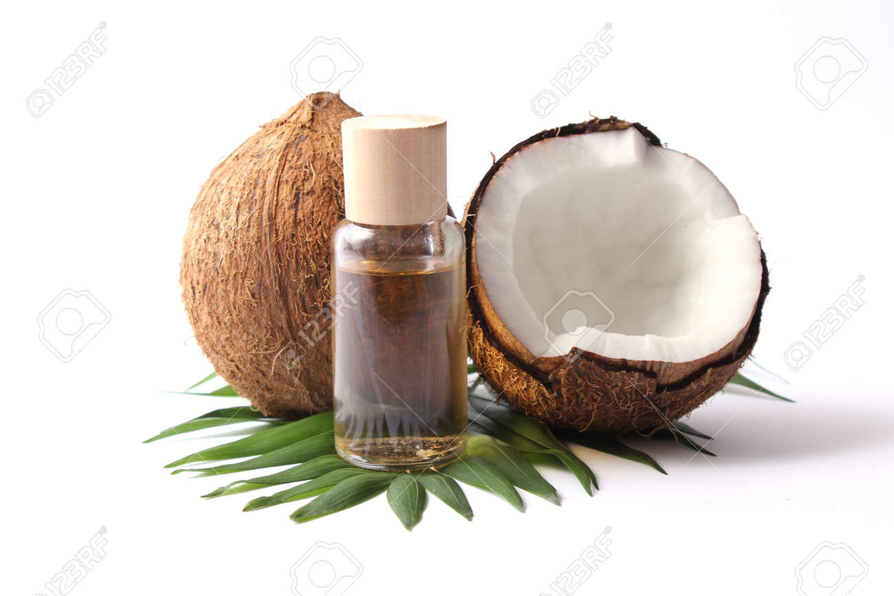 coconut oil and coconuts, palm branches close up - 168126537
