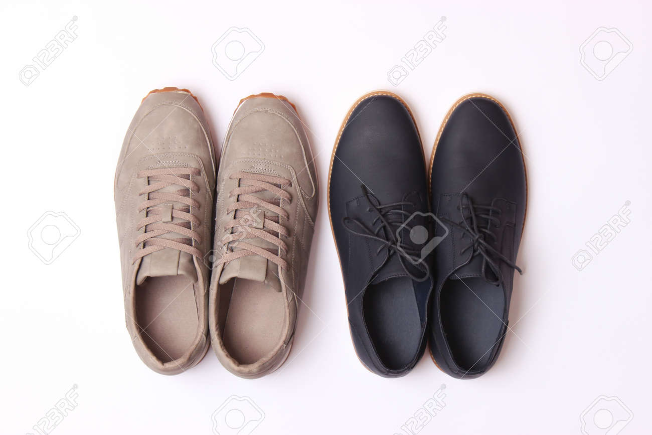 mens office shoes and sneakers on a colored background top view. mens shoes, - 168127220