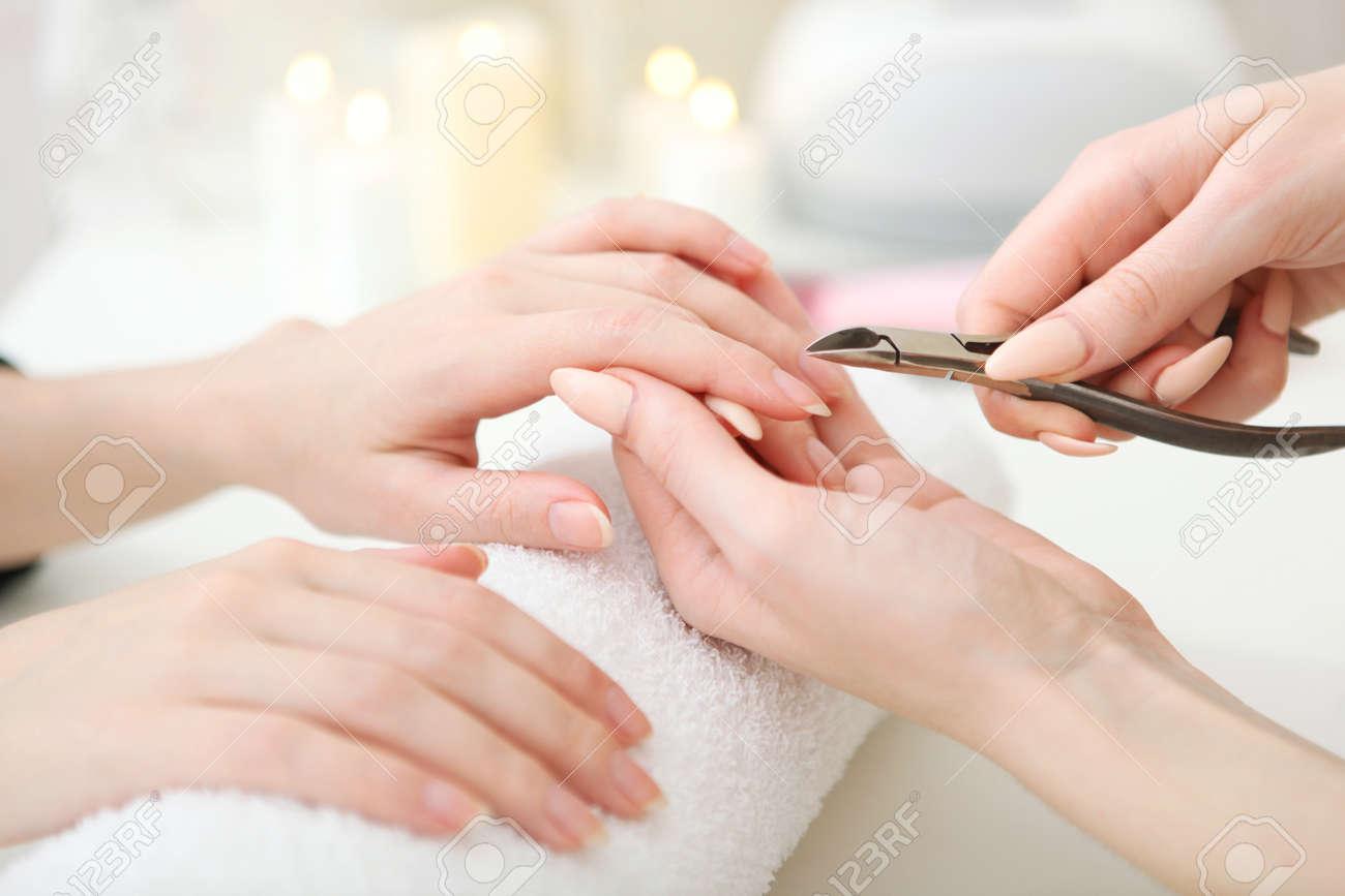 Closeup shot of a woman in a nail salon getting a manicure - 168614480