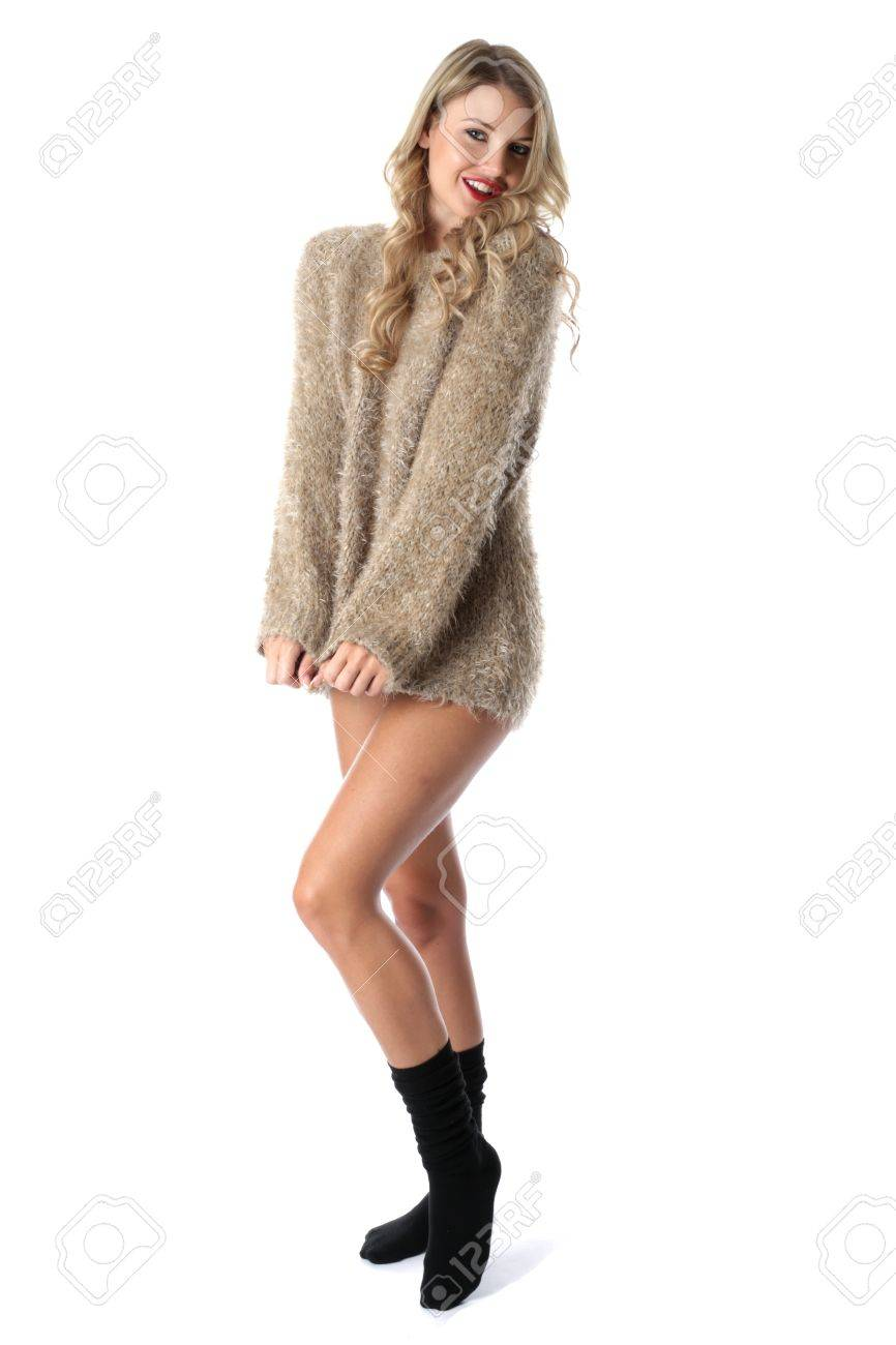 Model Released. Sexy Young Woman Wearing a Jumper and Socks Stock Photo - 21257174