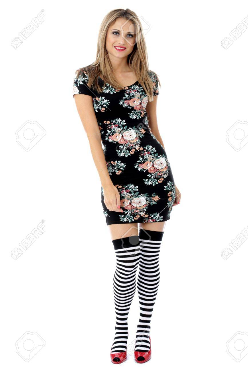 f29b5be8c Young Woman Modelling a Mini Dress with Knee Socks Stock Photo - 21340824