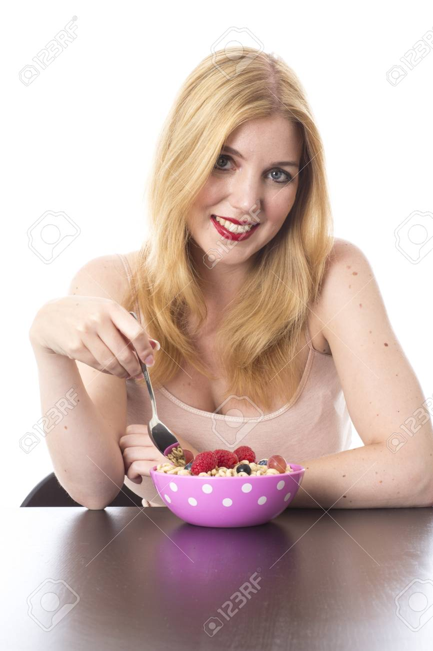 Model Released. Attractive Young Woman Eating Breakfast Cereal Stock Photo - 21898269