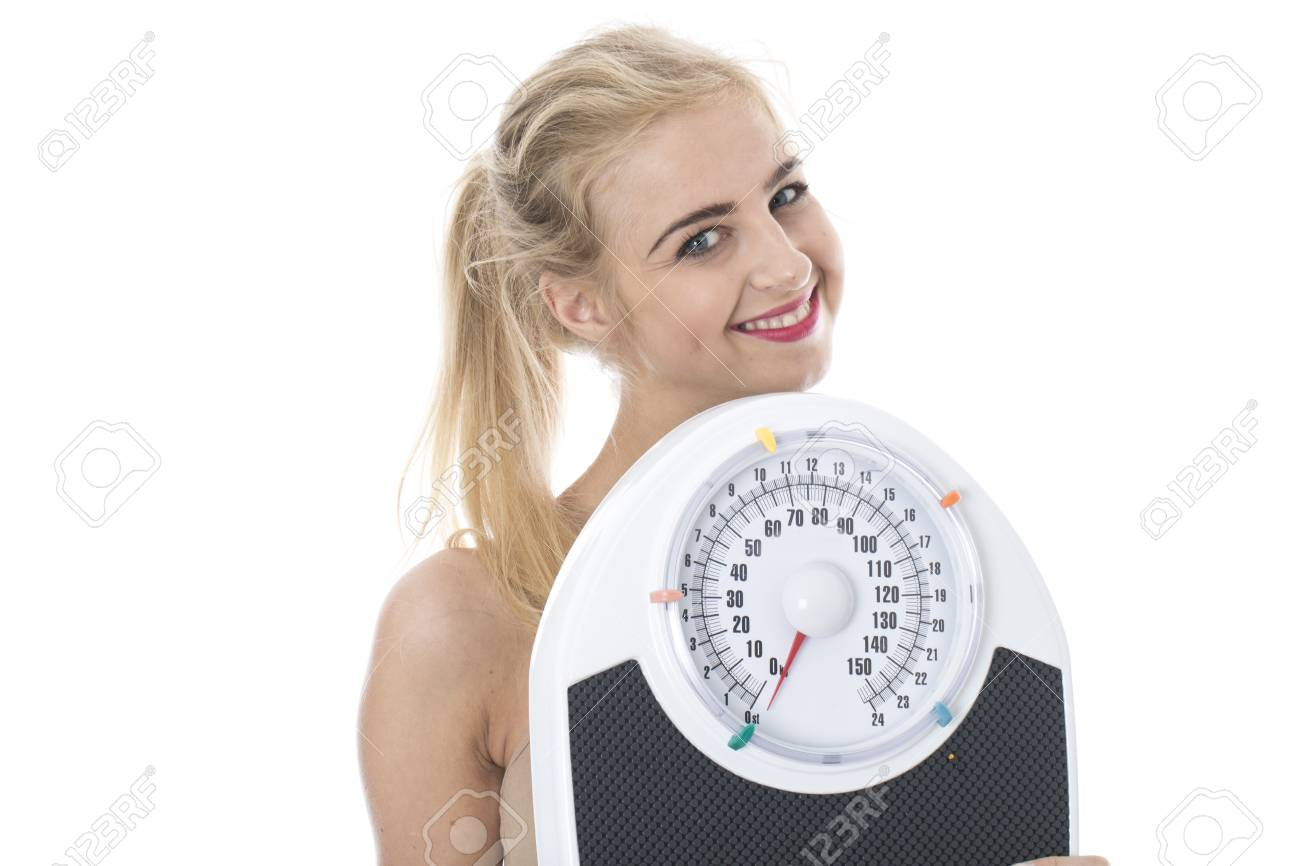 Attractive Young Woman with Bathroom Scales Stock Photo - 22301077