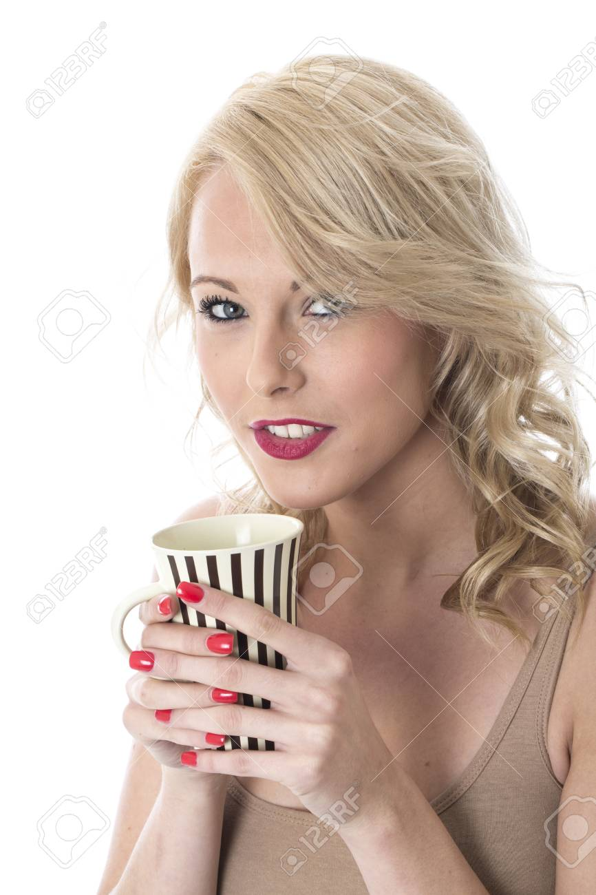 Model Released. Attractive Young Woman Drinking Coffee Stock Photo - 22337580