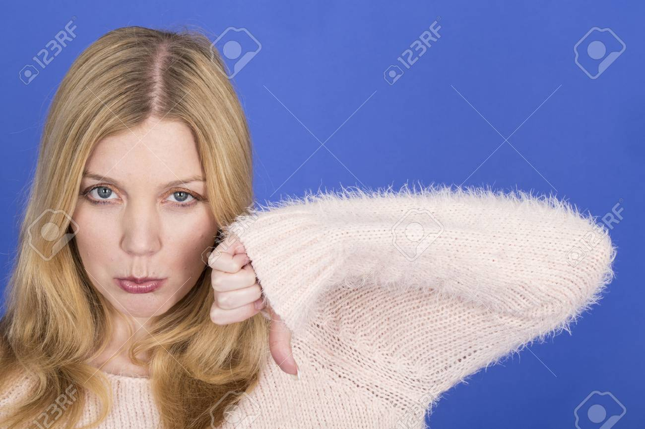 Model Released. Attractive Sad Young Woman Thumbs Down Stock Photo - 22910122