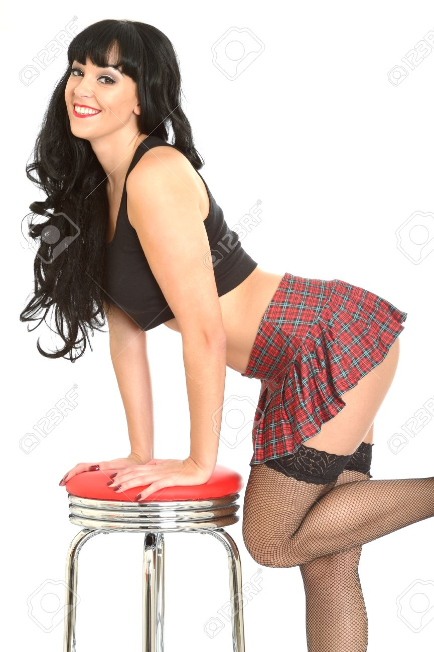 attractive young pin up model tartan mini skirt stock photo, picture
