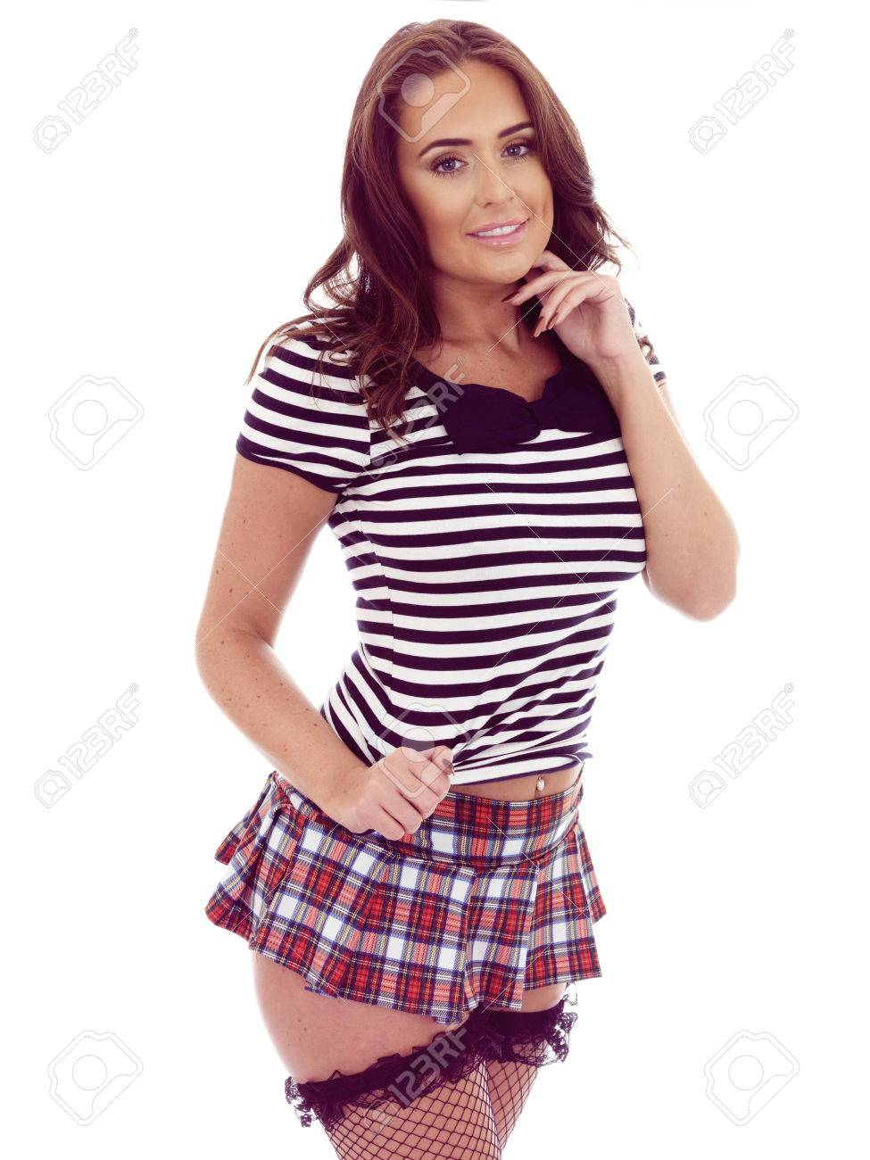 6f54089deb6a Beautiful Young Hispanic Woman Posing in a Very Short Mini Skirt Revealing  Her Stocking Tops Against