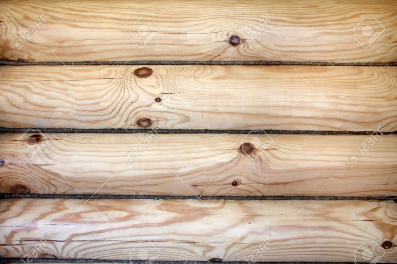 A Piece Of A Wall In A House Made Of Logs. Wood Texture Stock Photo