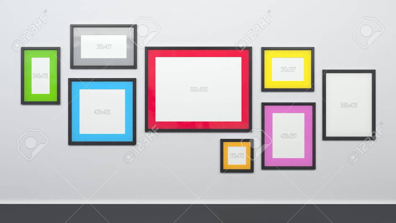White Wall With Different Size Graphic Picture Frames Stock Photo ...