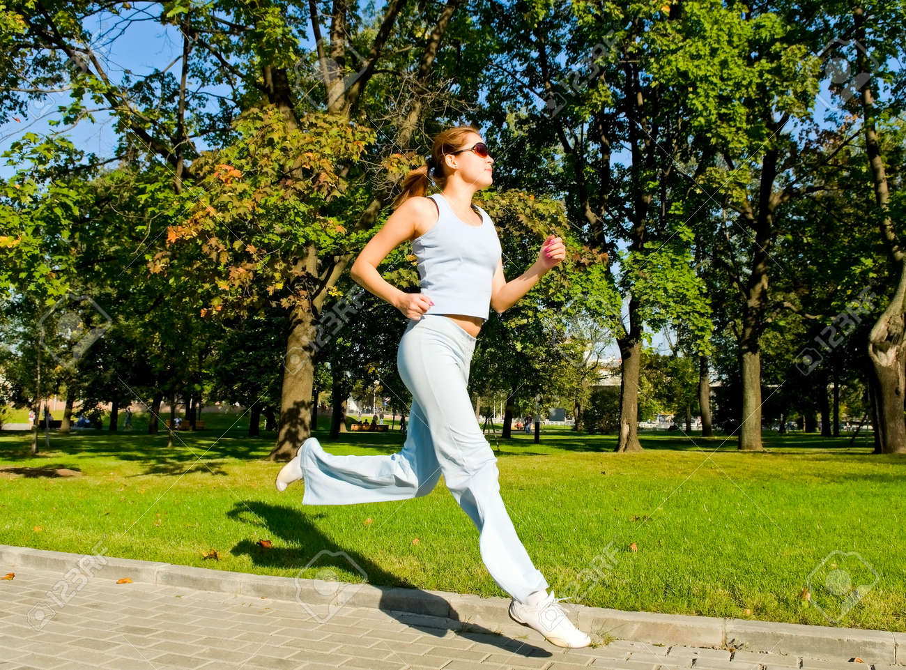 Young sexy woman running in the park Stock Photo - 6555447