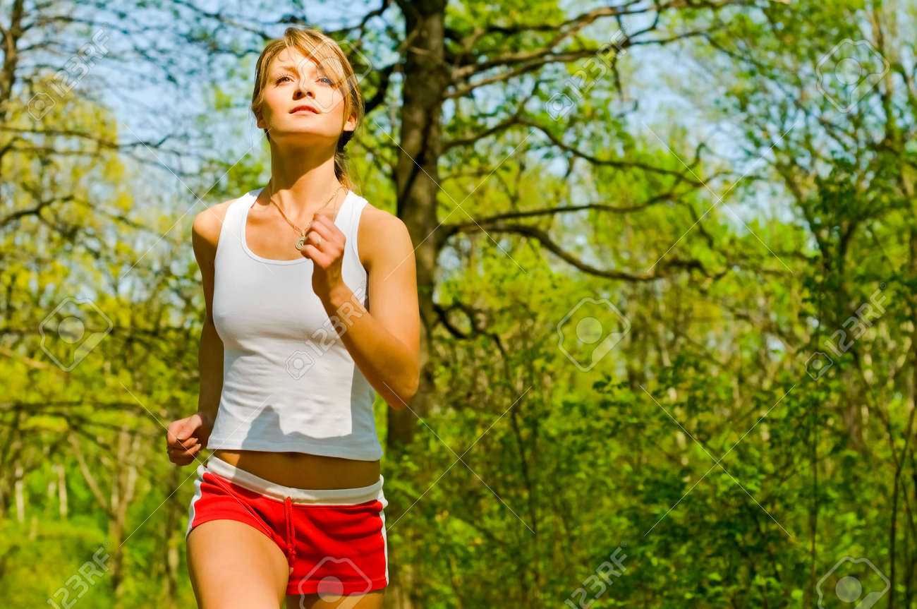 pretty young woman running in park Stock Photo - 6907044