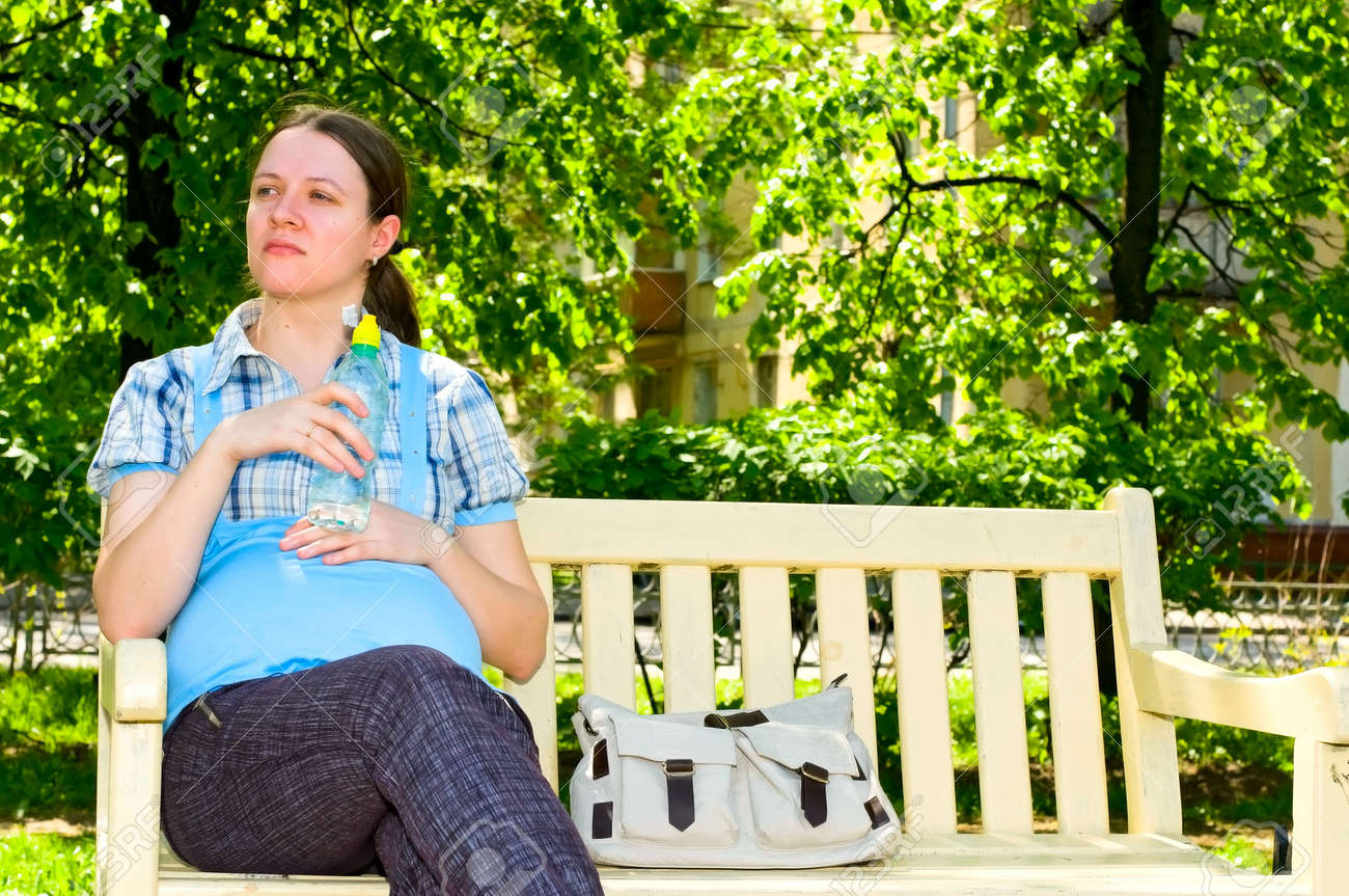 pregnant young woman with bottle of water Stock Photo - 7057949