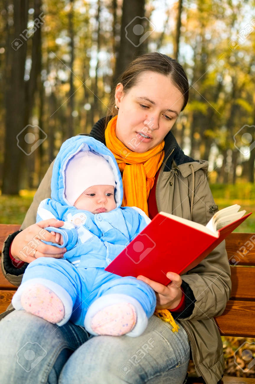 Portrait of mother with child reading book outdoors Stock Photo - 8086349