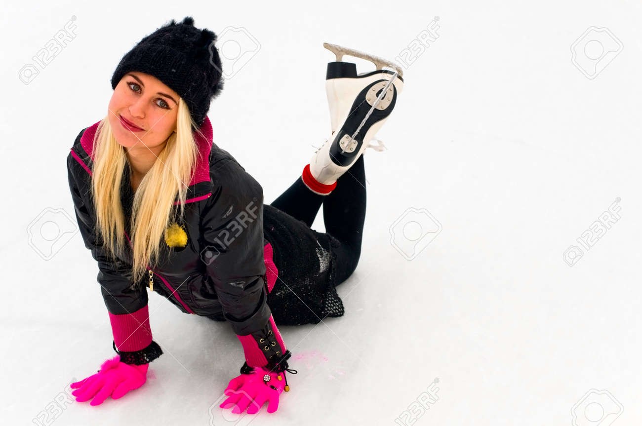 blonde young woman on ice skates Stock Photo - 8170541