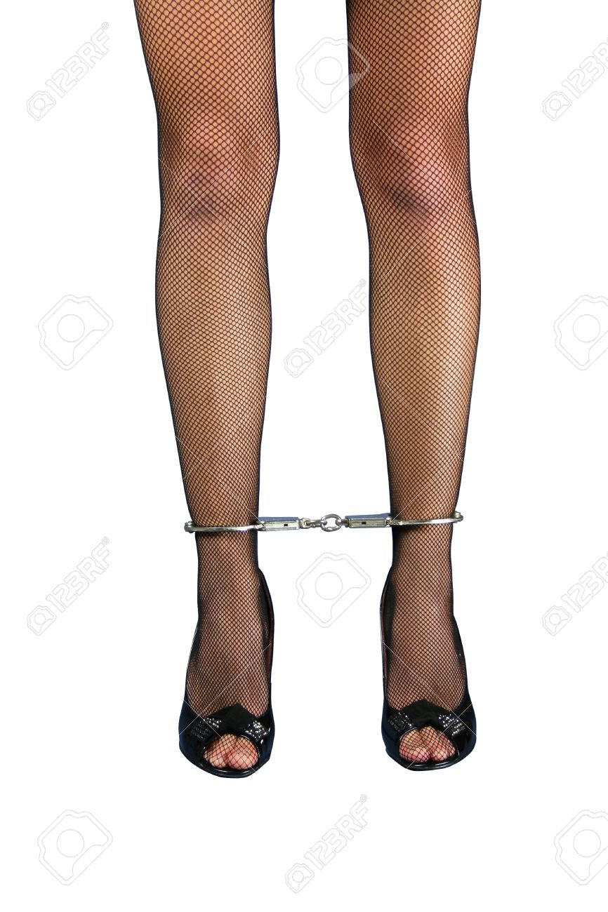 A pair of handcuffed female legs in pantyhose Stock Photo - 8251773