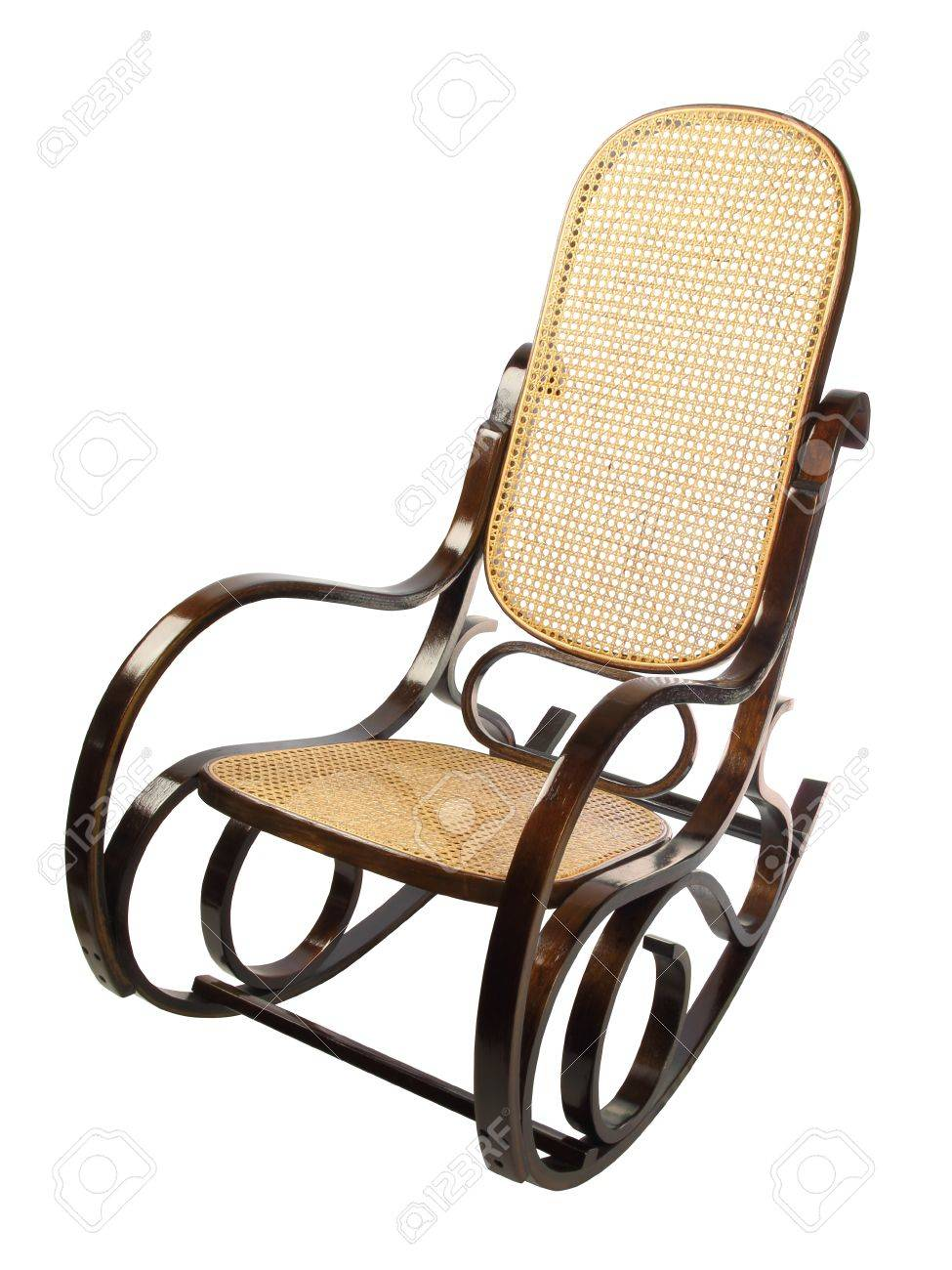 dark brown rocking chair with yellow braided back and seat Stock Photo - 9520113