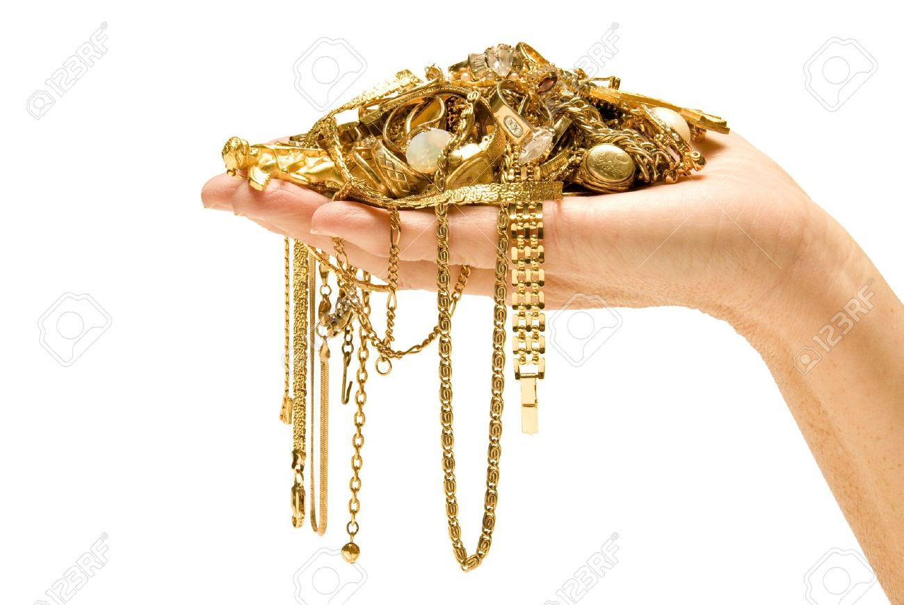 Hand holding gold Beautiful gold ready to sell Pile of jewelry in hand Isolated on white Studio shot - 17223581
