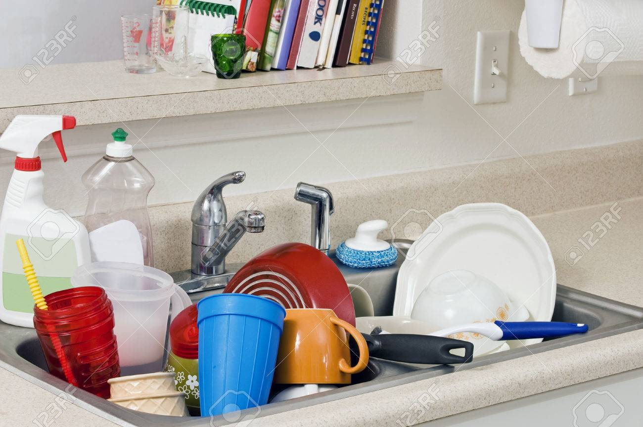 Kitchen Sink With Dishes dirty dishes piled high in kitchen sink stock photo, picture and
