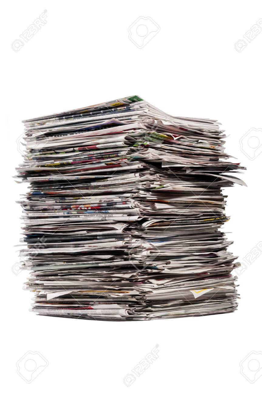 tall stack of newspapers on white background stock photo, picture