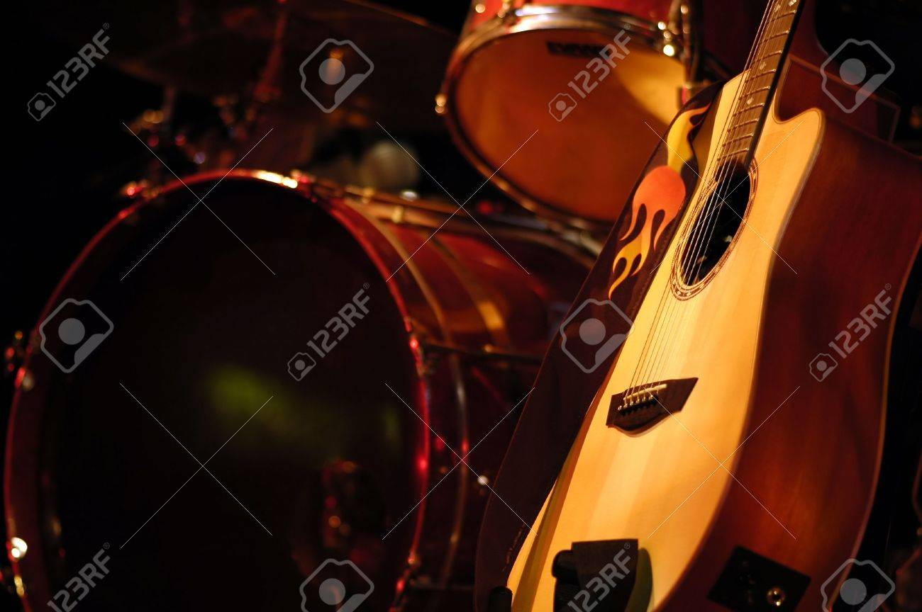 Drum Kit And Acoustic Guitar On Stage Stock Photo Picture And