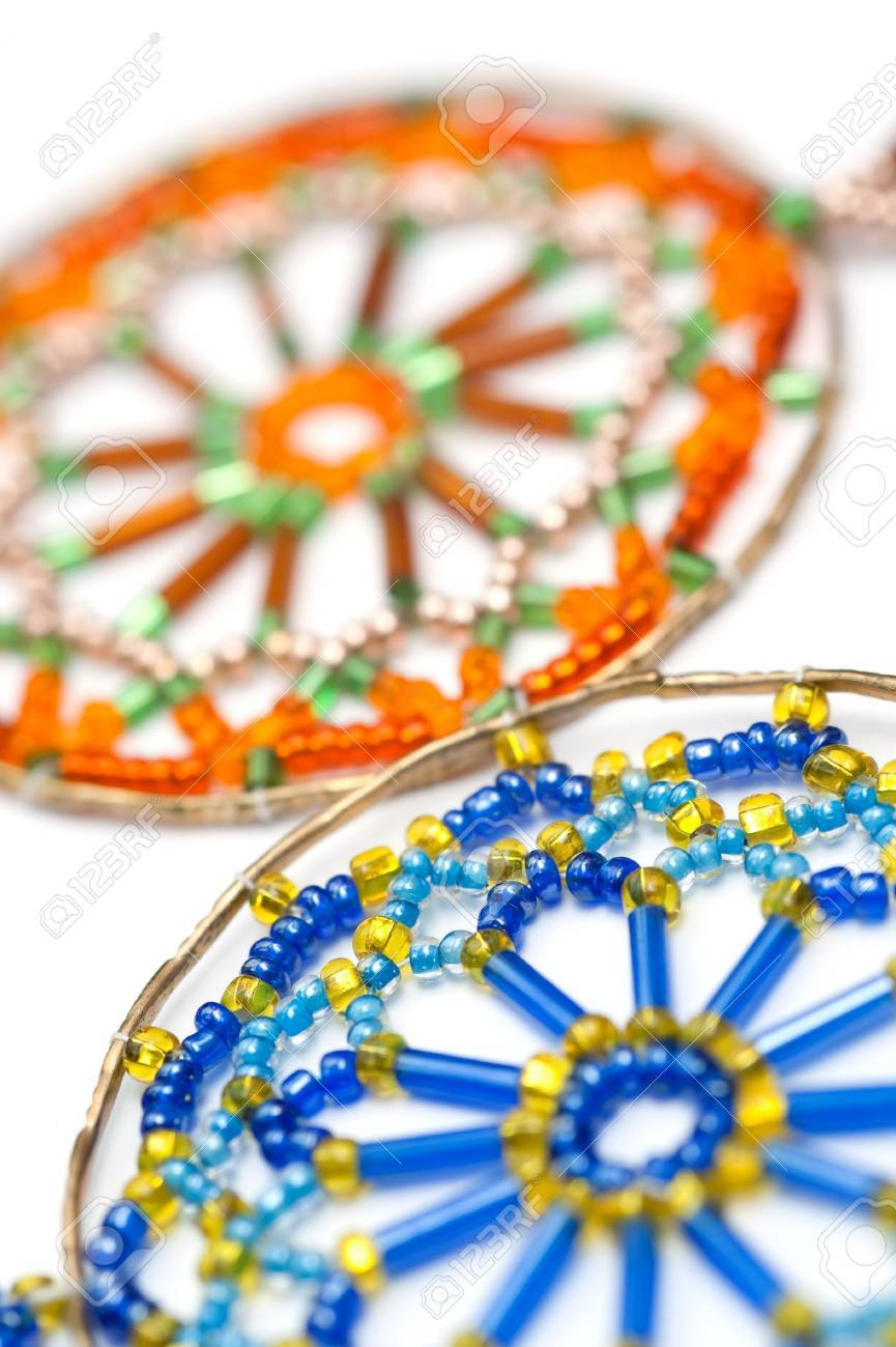 stock photo decorative craft beads in a web design inside a brass hoop - Decorative Crafts