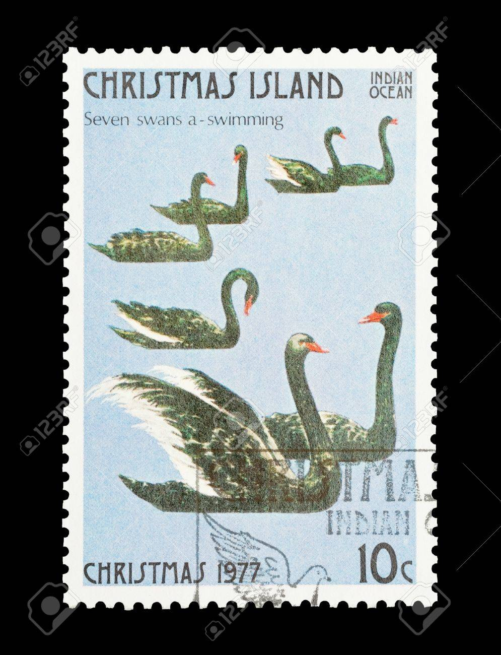 christmas island mail stamp featuring the seventh gift from the twelve days of christmas stock photo