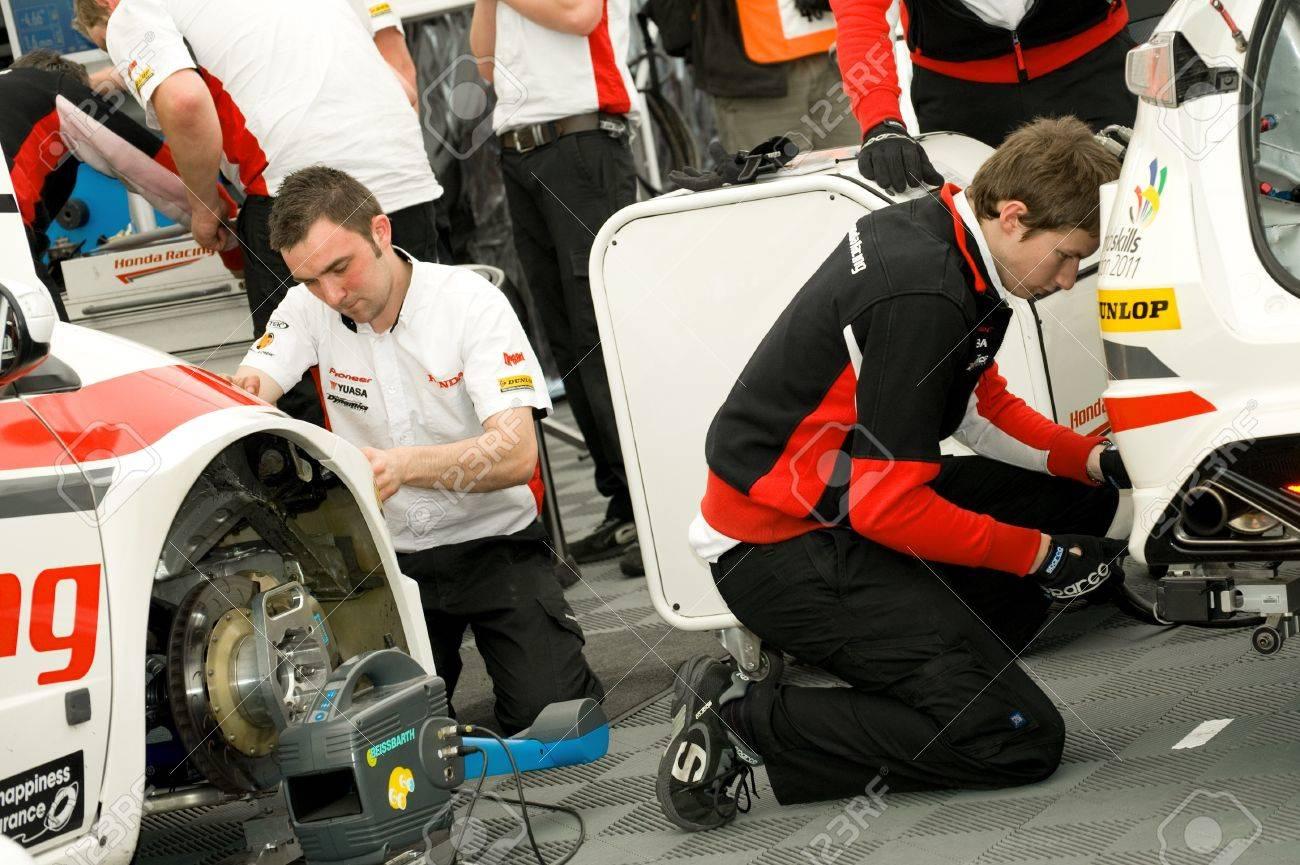 Thruxton, United Kingdom - May 1, 2011: Mechanics from the Honda team working on the race winning Civics at the British Touring Car Championship in Thruxton, UK Stock Photo - 9472284