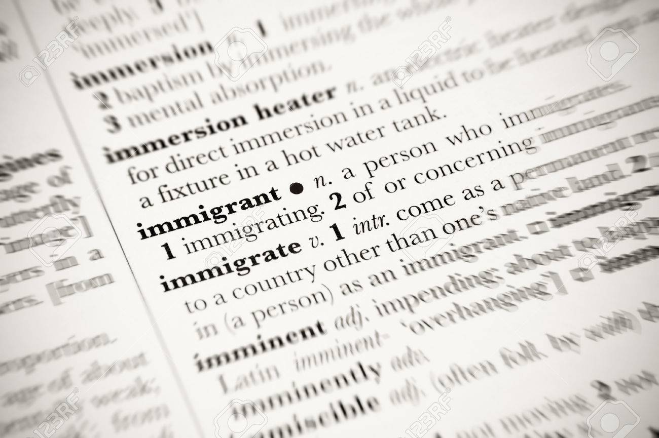 dictionary definition of immigrant with blurred edges stock photo