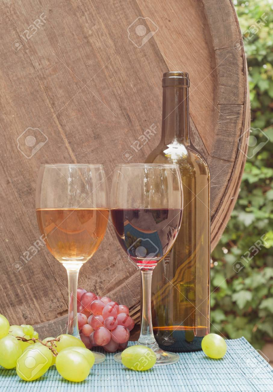 Glasses of wine on a wine barrel Stock Photo - 10923802