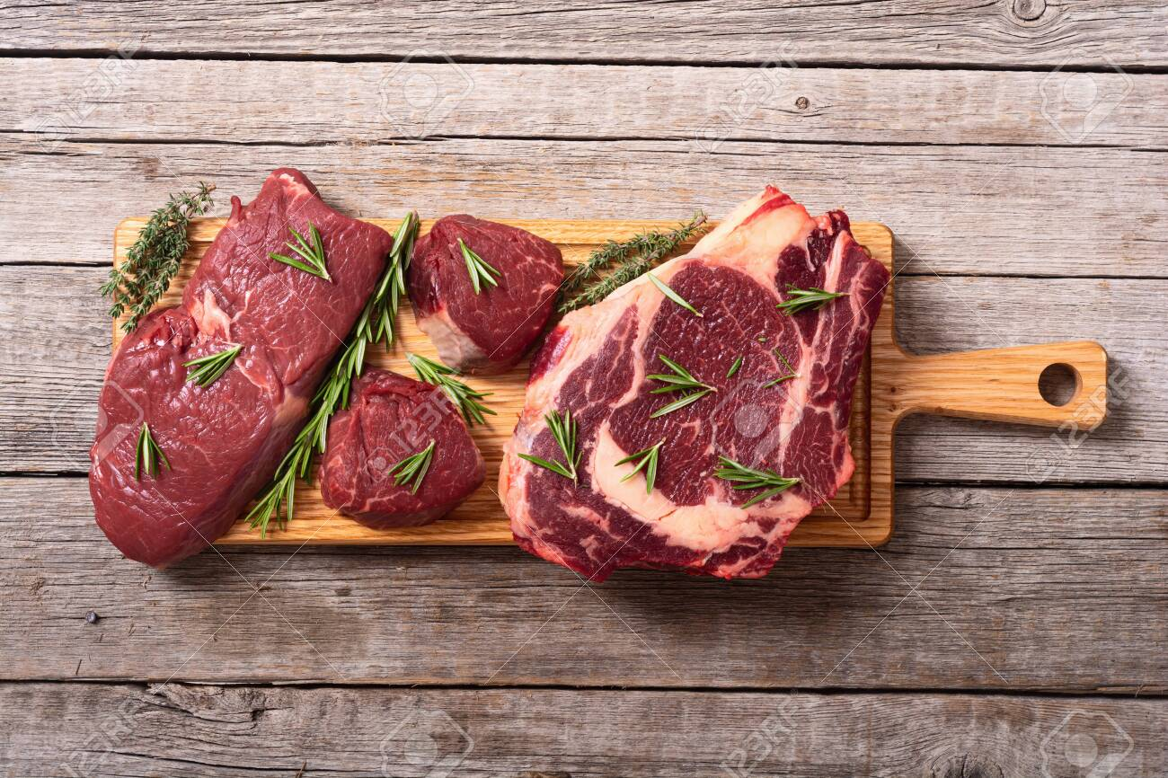 Set of raw beef steak with spices and salt. filet mignon, ribeye and striploin - 156061320