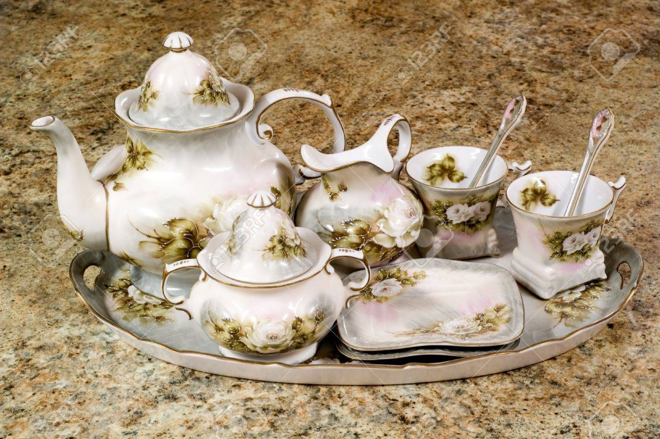 Floral tea set sitting on counter - 16947142