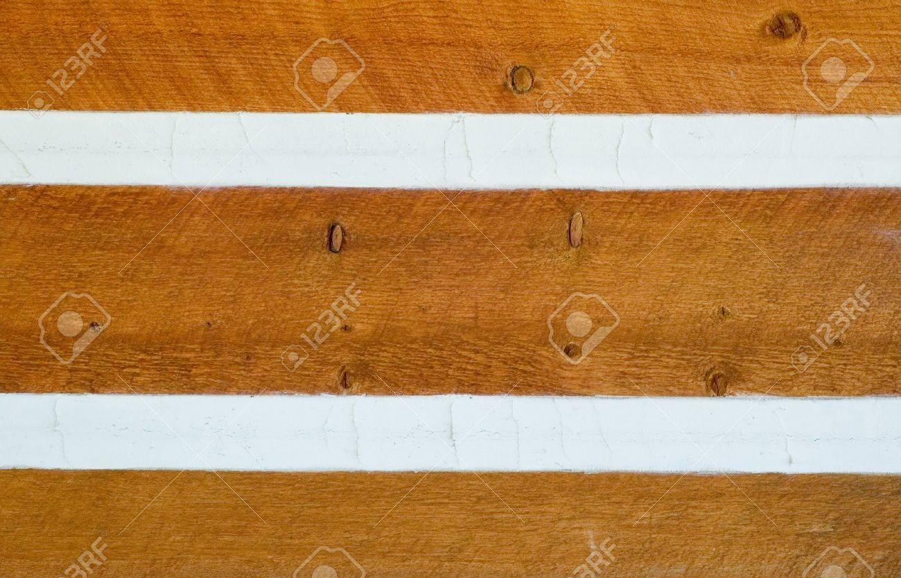 Siding on Log Cabin Sealed by Chinking - 16987730