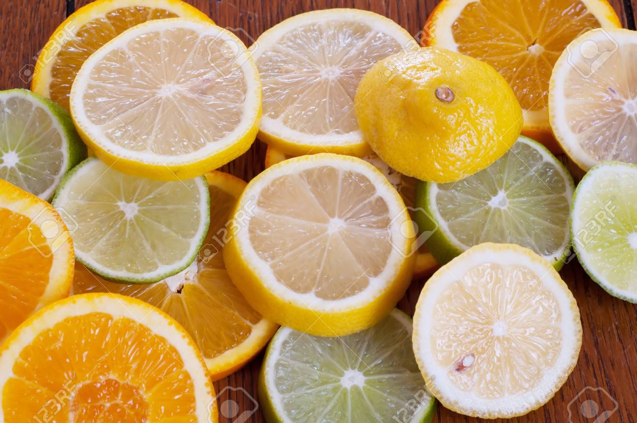Lemon, Lime and Orange Slices on a Table - 17033482