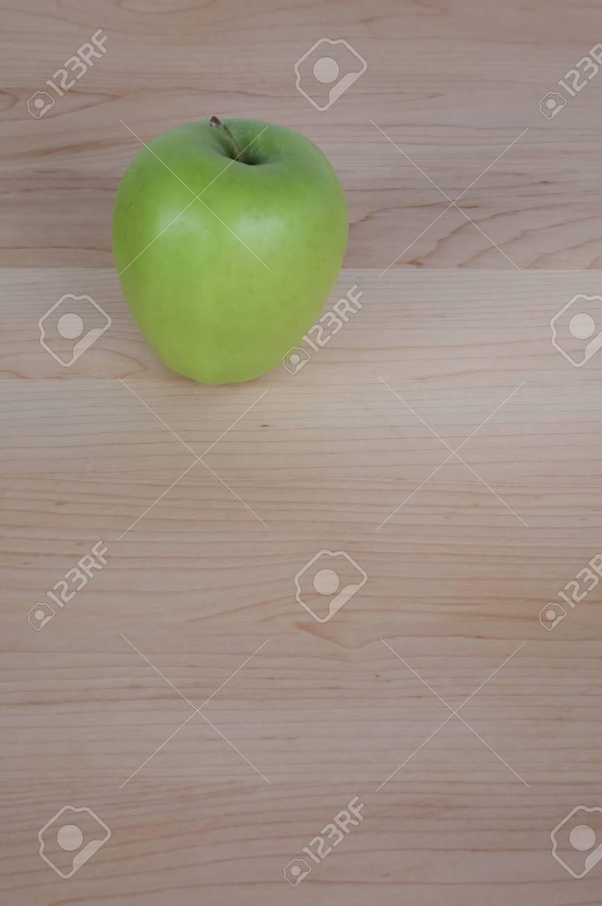 Green Apple on Desk or Cutting Board - 17083328