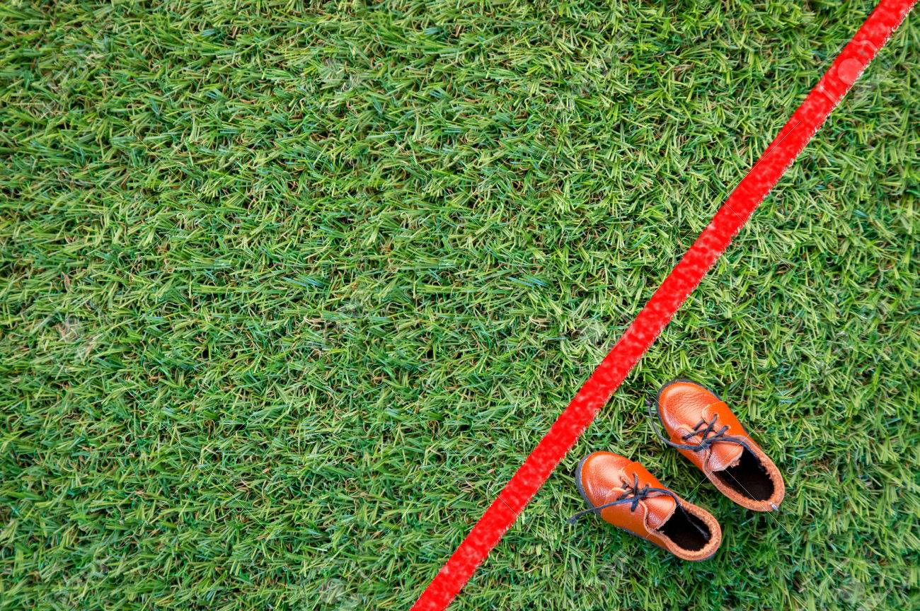 Line Drawing Grass : Shoe with red line drawing on grass floor challenge concept stock