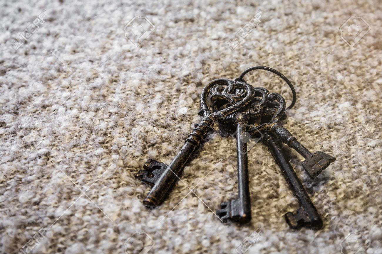 Antique and rusty medieval castle skeleton door keys with old corroded  metal ring on antique weathered - Antique And Rusty Medieval Castle Skeleton Door Keys With Old