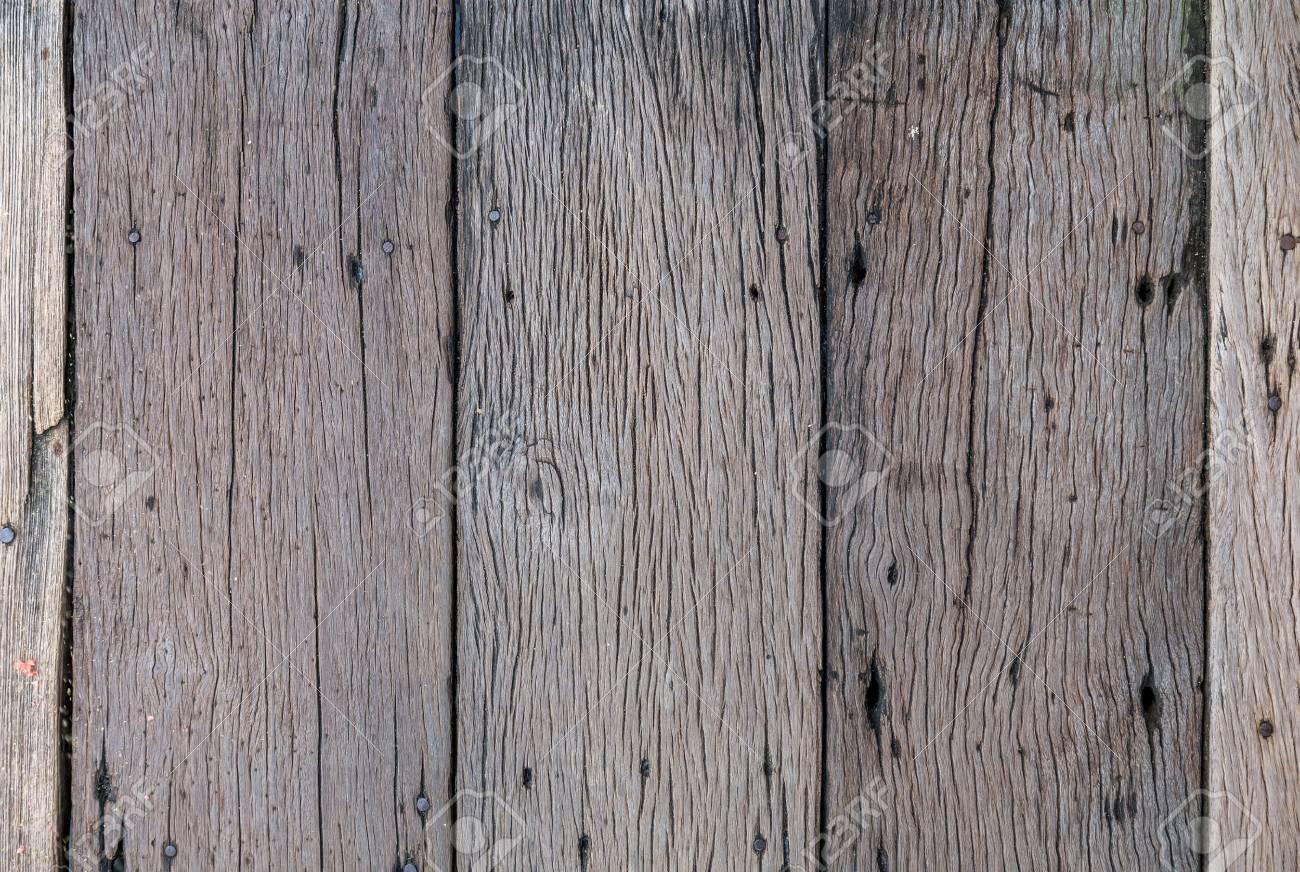 La Plinthe Du Mur vieille planche mur en bois fond endommagé par le temps et les insectes