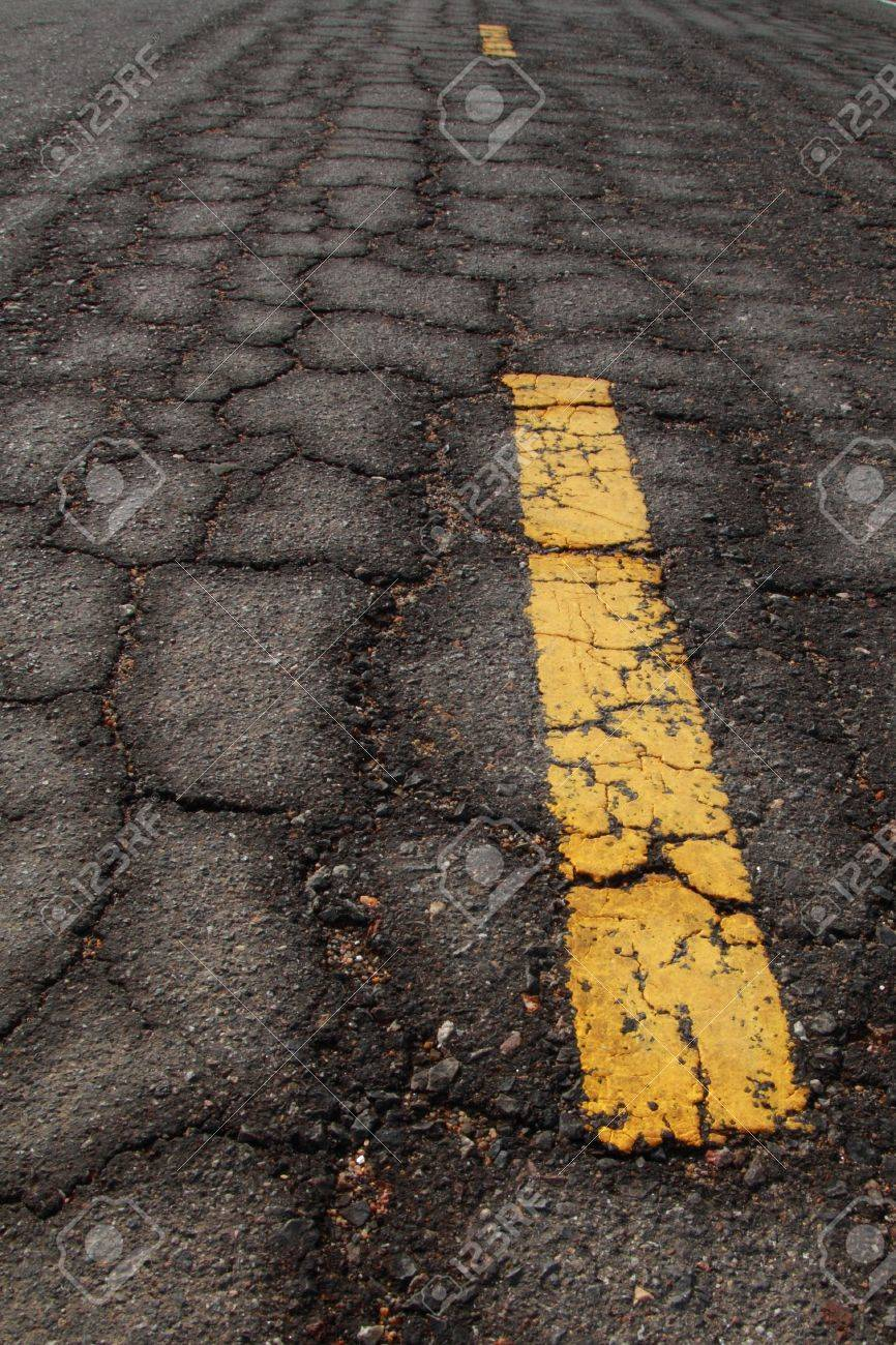 old Asphalt road cracked pattern  with old traffic marking. Stock Photo - 7131377