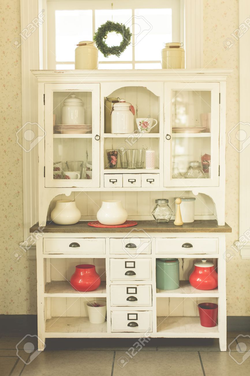 Antique Kitchen Cabinet And Old Style Kitchen Ware In Pastel ...